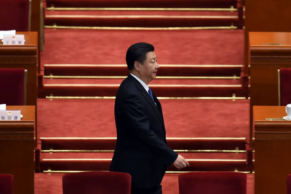 Chinese President Xi Jinping arrives for the 2nd plenary session of the National People's Congress in the Great Hall of the People in Beijing on March 9, 2016.; Getty
