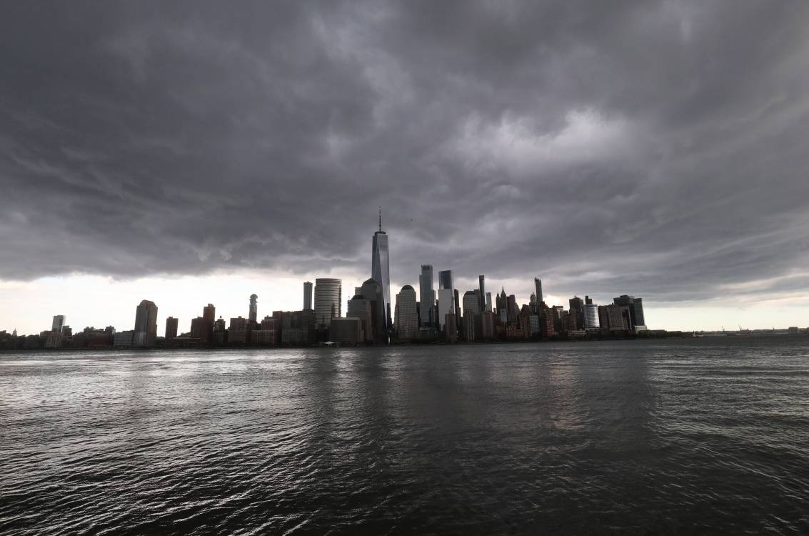 A rain storm passes over lower Manhattan and One World Trade Center in New York City on May 11, 2020 as seen from Jersey City, New Jersey.; Getty