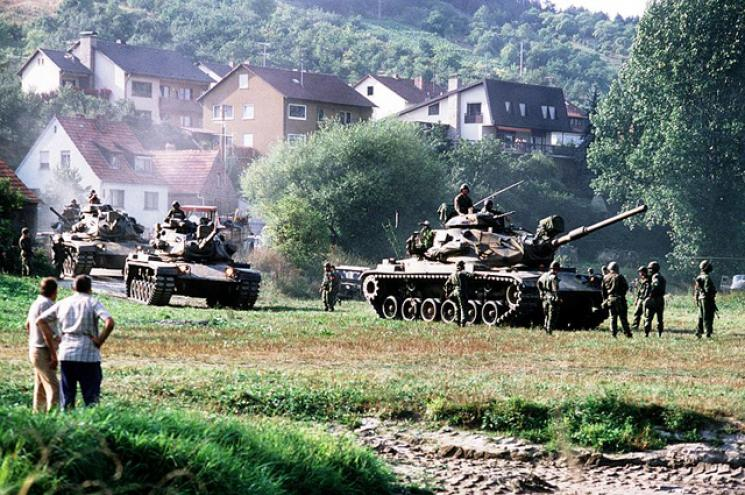 Tanks maneuvering in a field