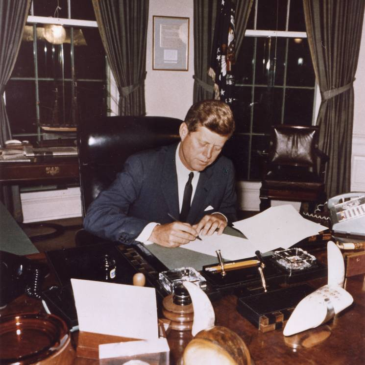 "President Kennedy signs the ""Proclamation for Interdiction of the Delivery of Offensive Weapons to Cuba."""