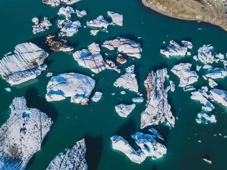 Icebergs float in the Jokulsarlon glacial lagoon in Iceland. The glacier that feeds this lagoon is retreating rapidly.