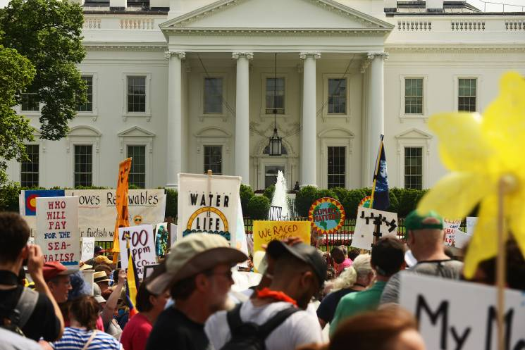 Demonstrators march near the White House