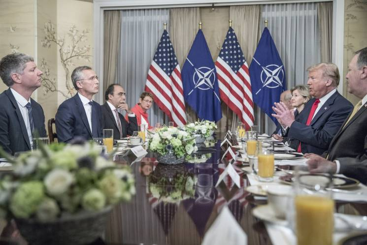 NATO leaders sitting around a long table.