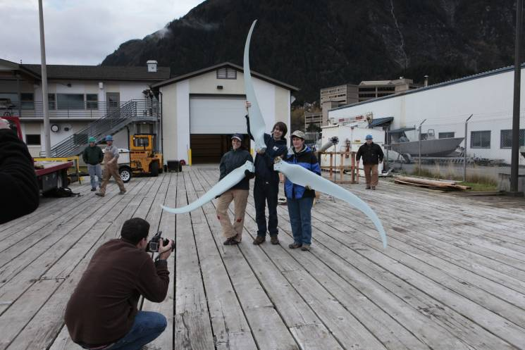 Young Alaskan schoolchildren learn about and assemble a miniature wind turbine.