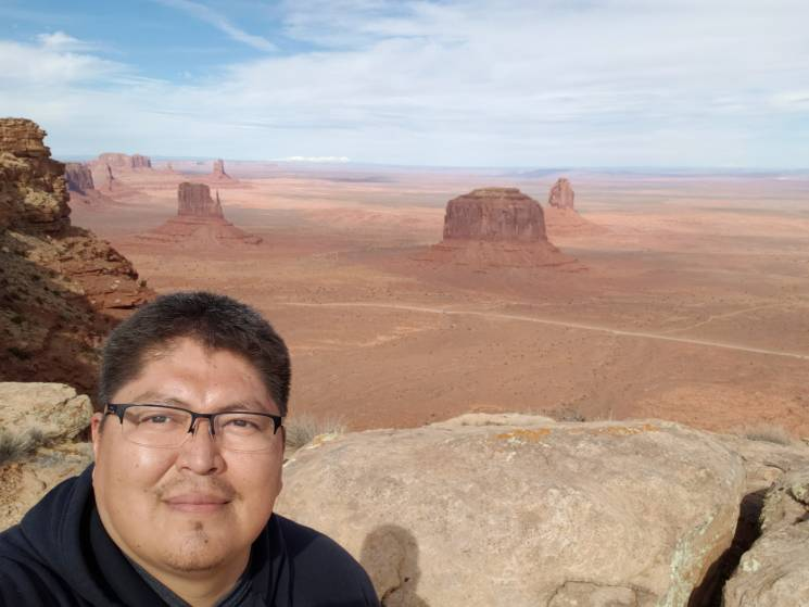 selfie in front of desert mesas