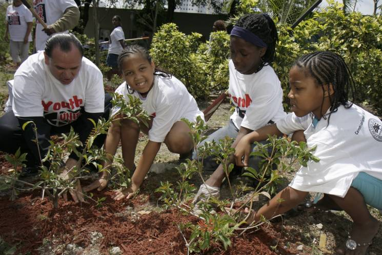 A group of volunteers from Global Youth Service Day planting trees in Peace Park.