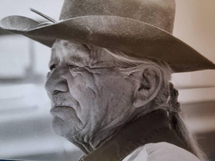 old man in cowboy hat