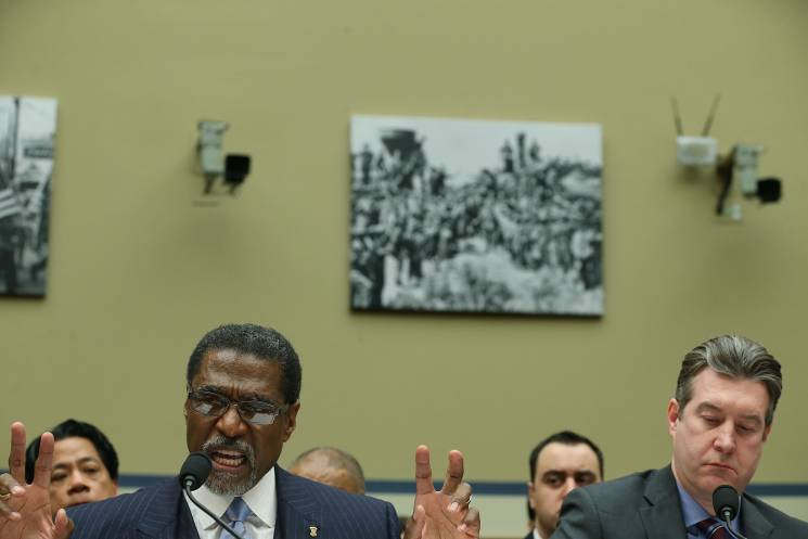 Former Emergency Manager Darnell Earley and Former Flint Mayer Dayne Walling testfy during a hearing on the Flint water crisis;Getty Images
