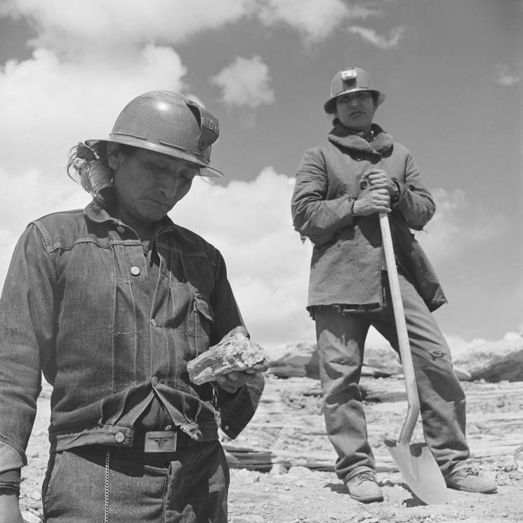 Two Navajo miners standing