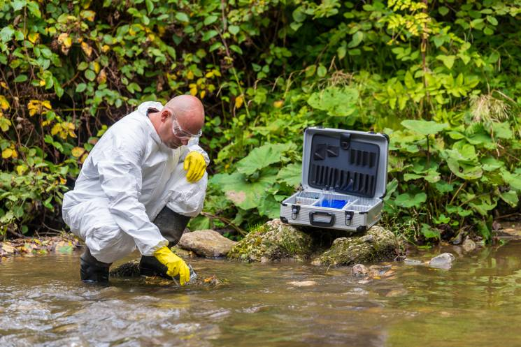 Testing a local stream for pesticide pollution; Getty Images