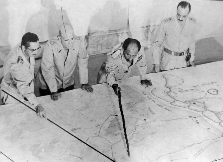 war planners look at map