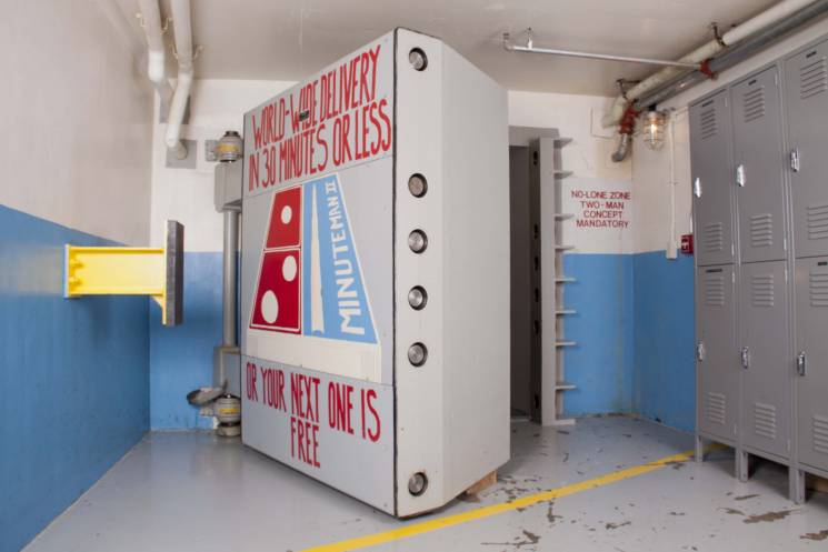 nuclear blast door with Dominos pizza box painted on it