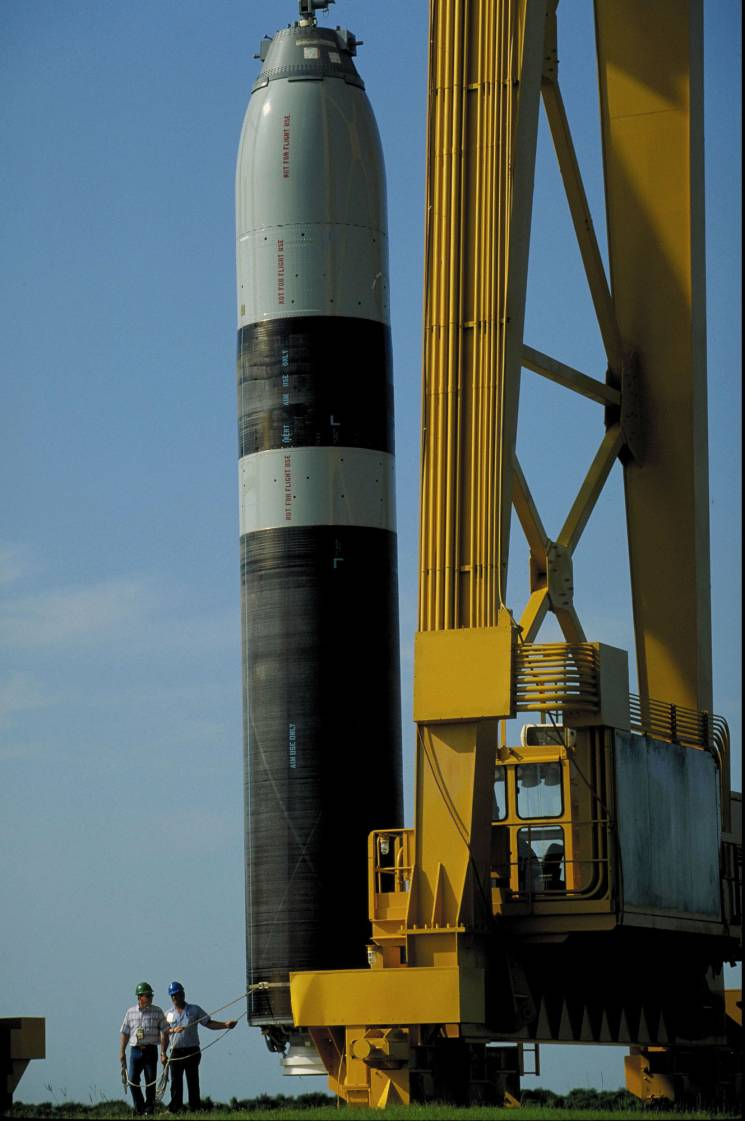 two workmen and a missile