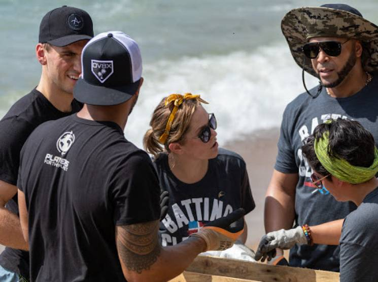 Major League Baseball players cleaning up a beach in The Dominican Republic; Players for the Planet