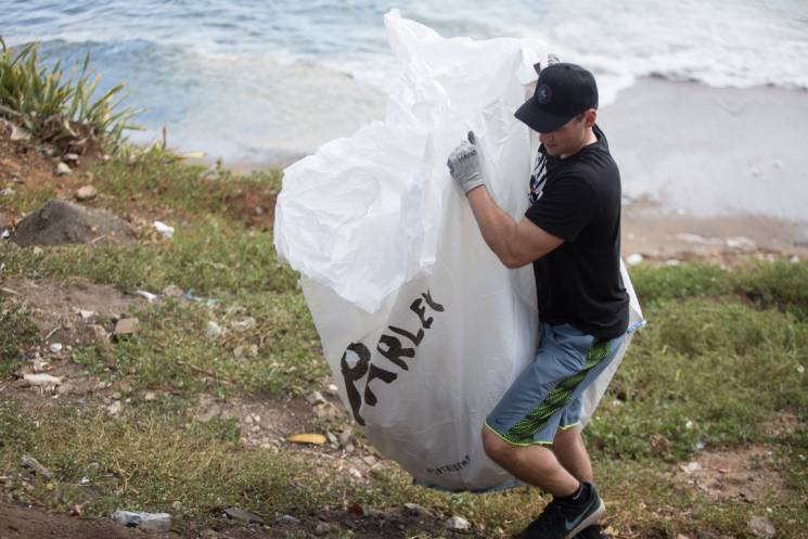 Brent Suter on beach cleanup duty; Players for the Planet