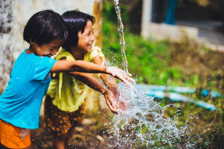 Children Playing with Water; Photo by Abigal Keenan on Unsplash