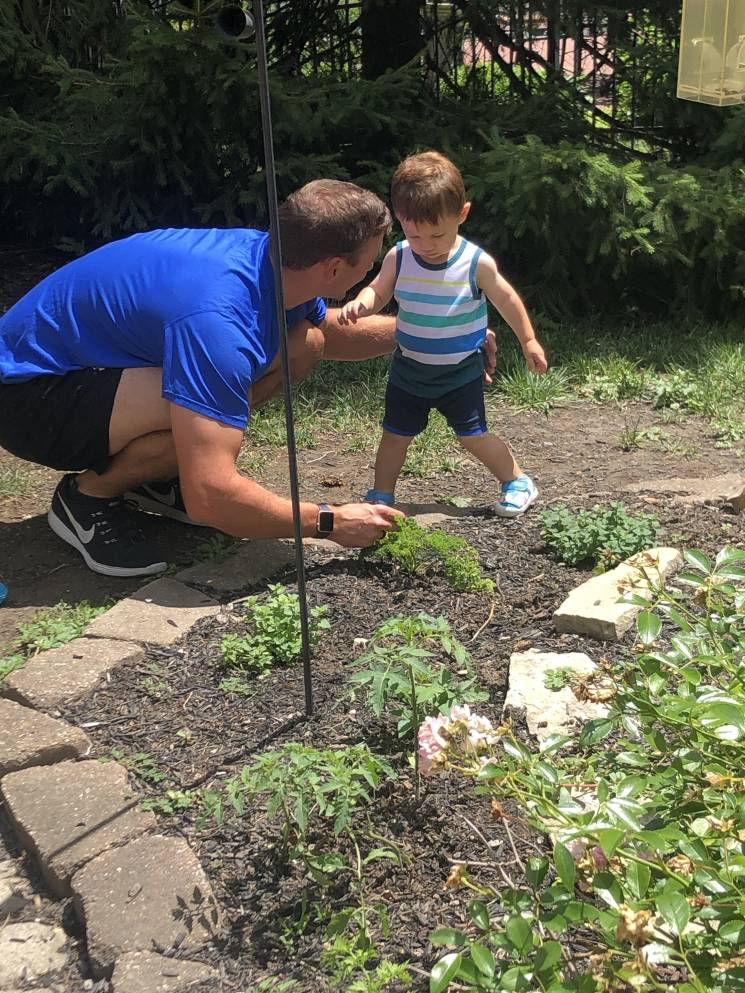 Brent Suter's son Liam is learning how to garden; Brent Suter
