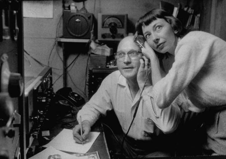 man and woman listen to ham radio headset