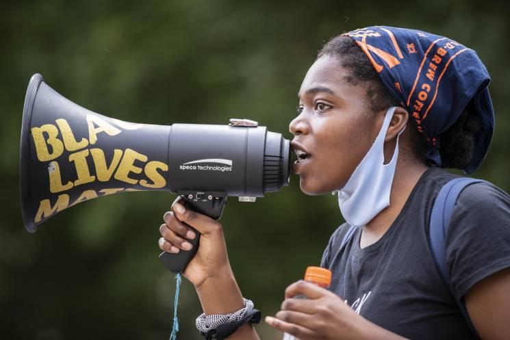 woman holds a megaphone