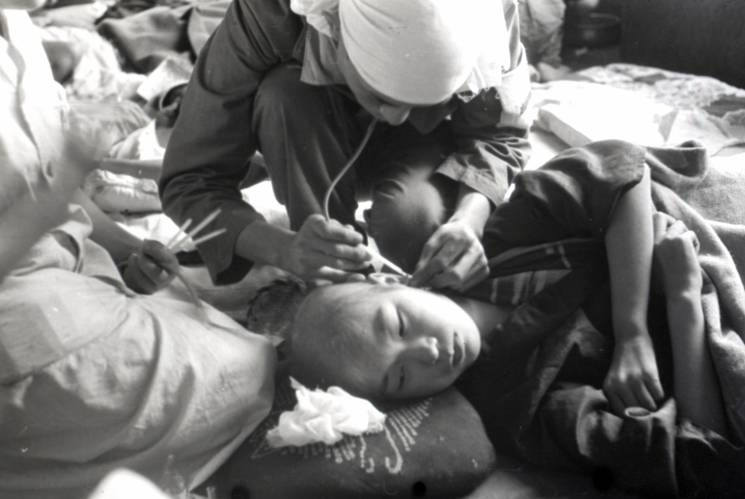Sick person cared for by a nurse