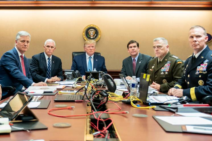 Trump and officials sit at table