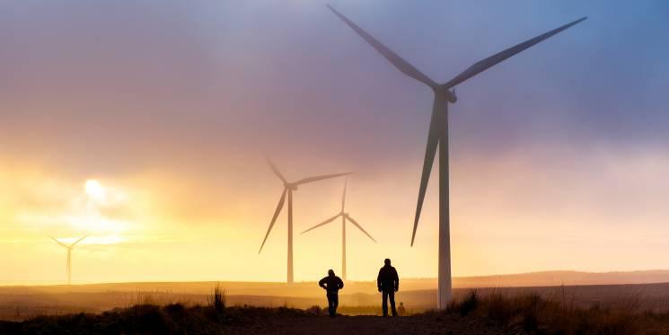 Sun rises over a wind farm; Getty