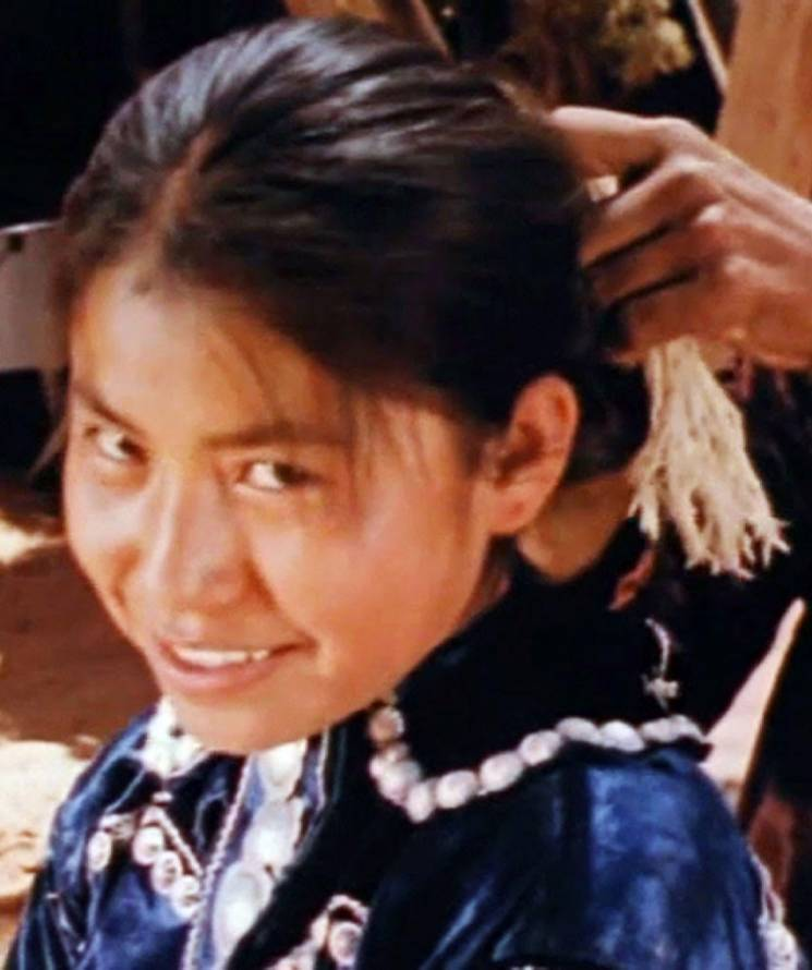 young native girl smiles at the camera