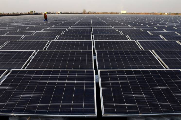 his photo taken on December 11, 2017 shows a general view of a floating solar power plant in Huainan, a former coal-mining region, in China's eastern Anhui province.; Getty