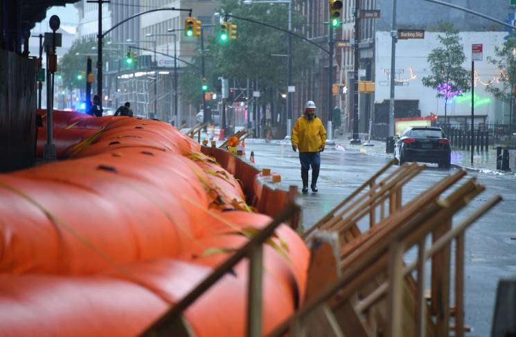 Flood barriers are placed on a street as Tropical Storm Isaias approaches New York City on August 4, 2020.; Getty
