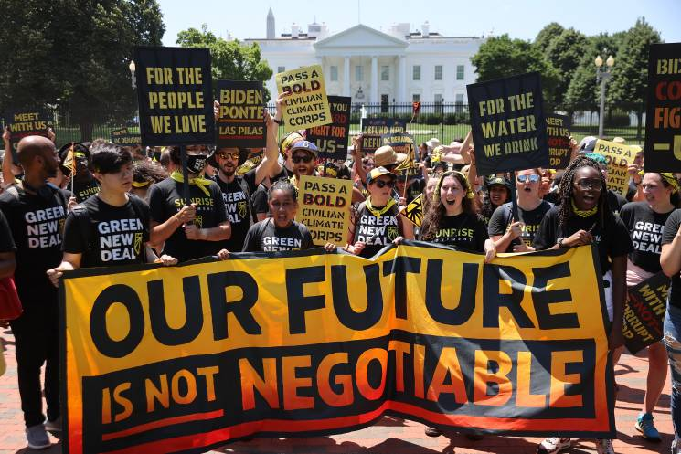 young climate activists rally in Lafayette Square on the north side of the White House to demand that U.S. President Joe Biden work to make the Green New Deal into law on June 28, 2021 in Washington, DC.; Getty