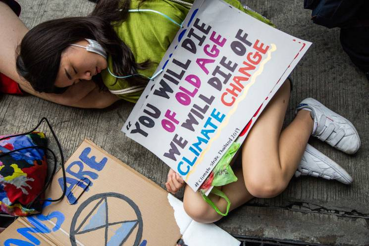 A youth activist takes part in a climate