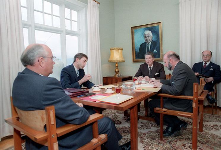President Reagan and General Secretary Gorbachev in discussion, seated at a table in a meeting room in Reykjavik, Iceland.