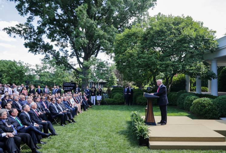 President Trump speaks in front of an audience outside the White House, announcing that the US is pulling out of the Paris Agreement