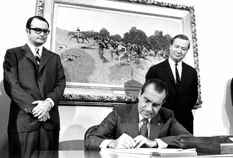 President Nixon signs the act establishing the EPA