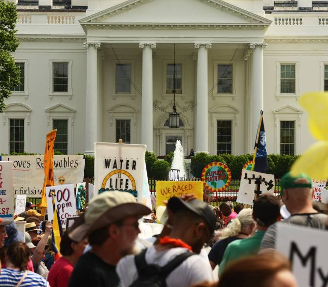 Demonstrators march near the White House on April 29, 2017. People came out to protest President Donald Trump's attacks on climate policies.
