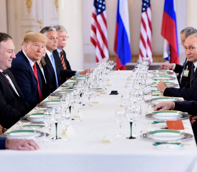 U.S. and Russian delegations sitting at a long table