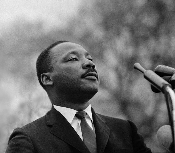 Martin Luther King Jr at the microphone