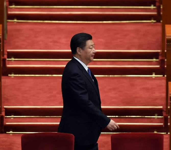 Chinese President Xi Jinping arrives for the 2nd plenary session of the National People's Congress in the Great Hall of the People in Beijing on March 9, 2016. Communist-controlled parliament opened on March 5 to approve a new five-year plan to tackle slowing growth in the world's second-largest economy; Getty