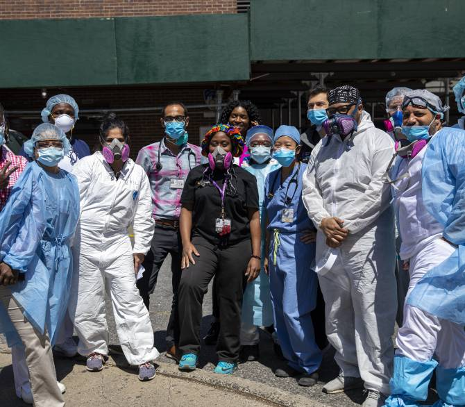 Doctors, nurses and emergency medical staff of the Brooklyn Hospital Center pose of a picture; Getty