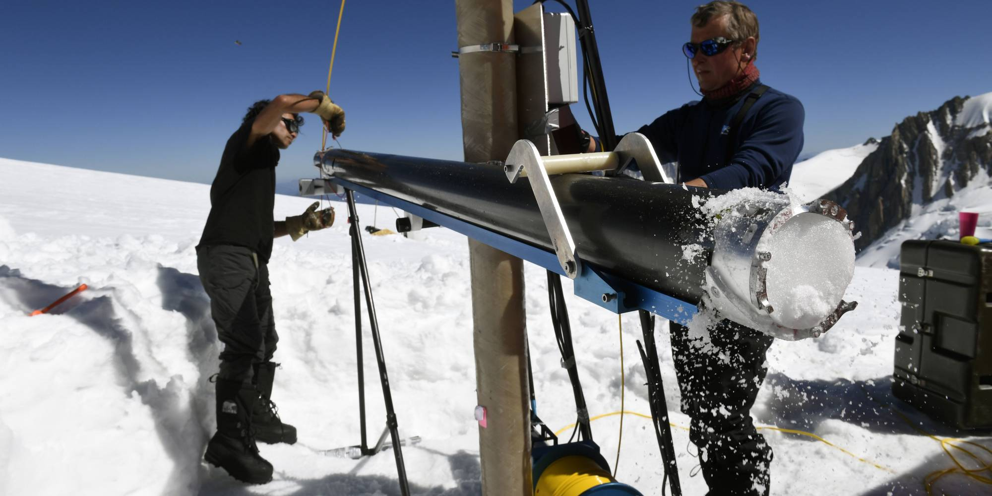 scientists extract an ice core