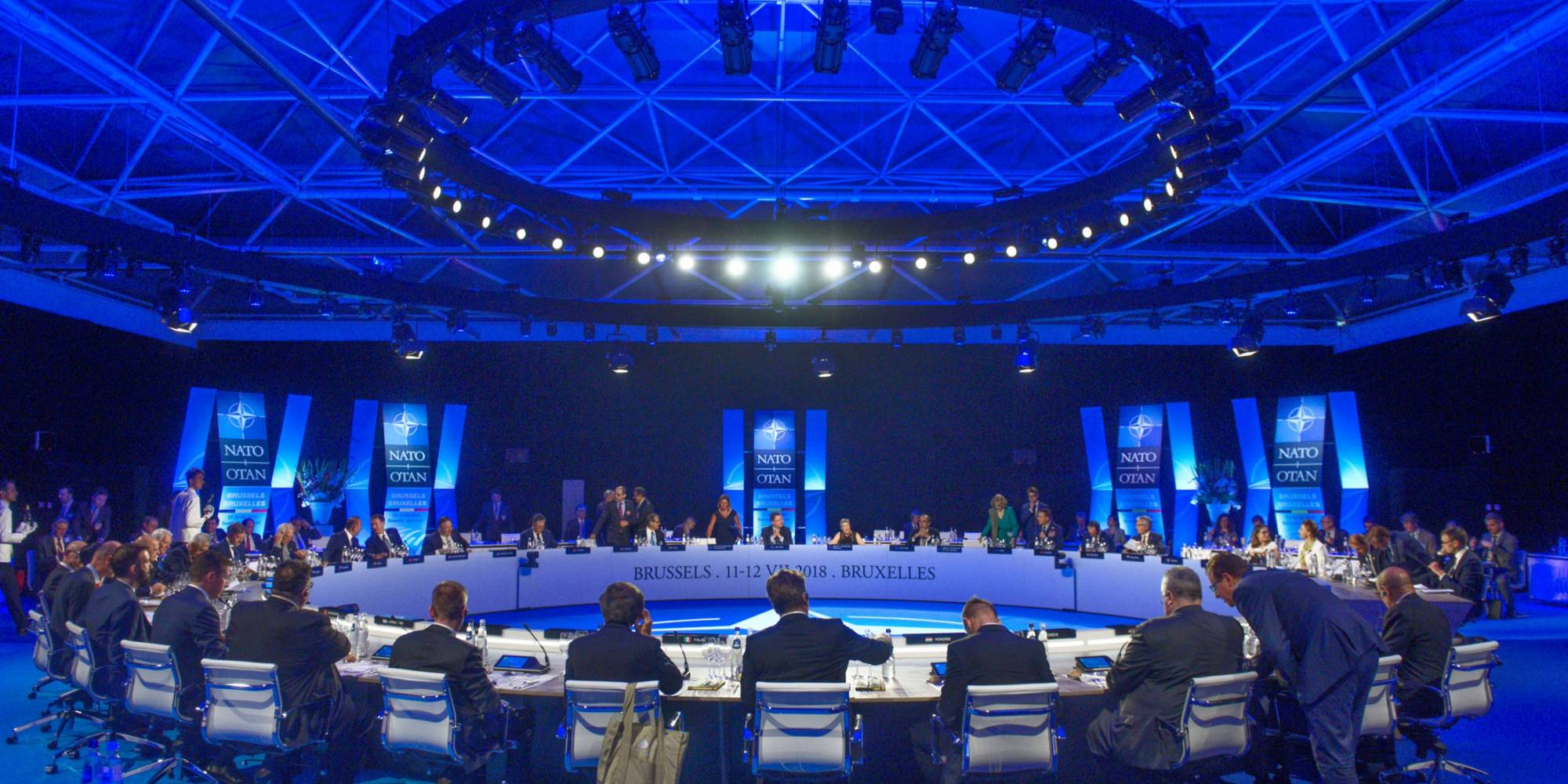 NATO Foreign Ministers sit around a circular table.