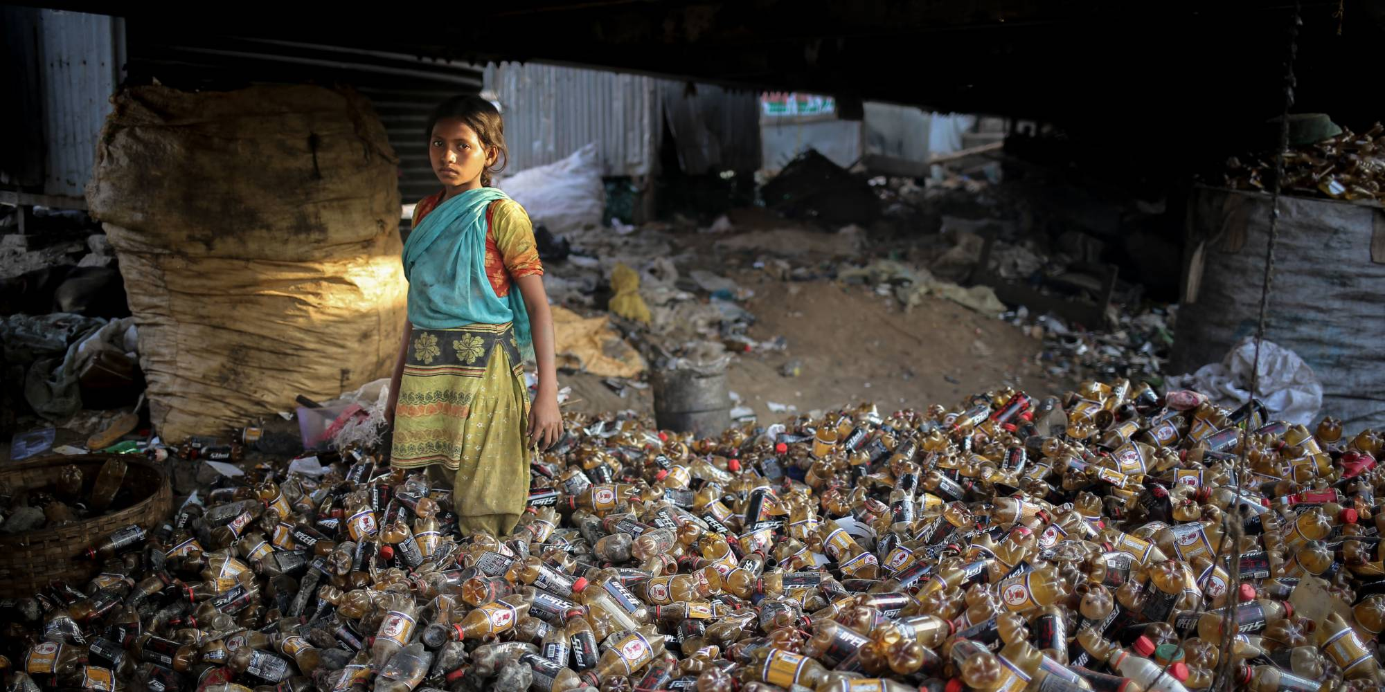 young girl in plastic bottle recycling facility
