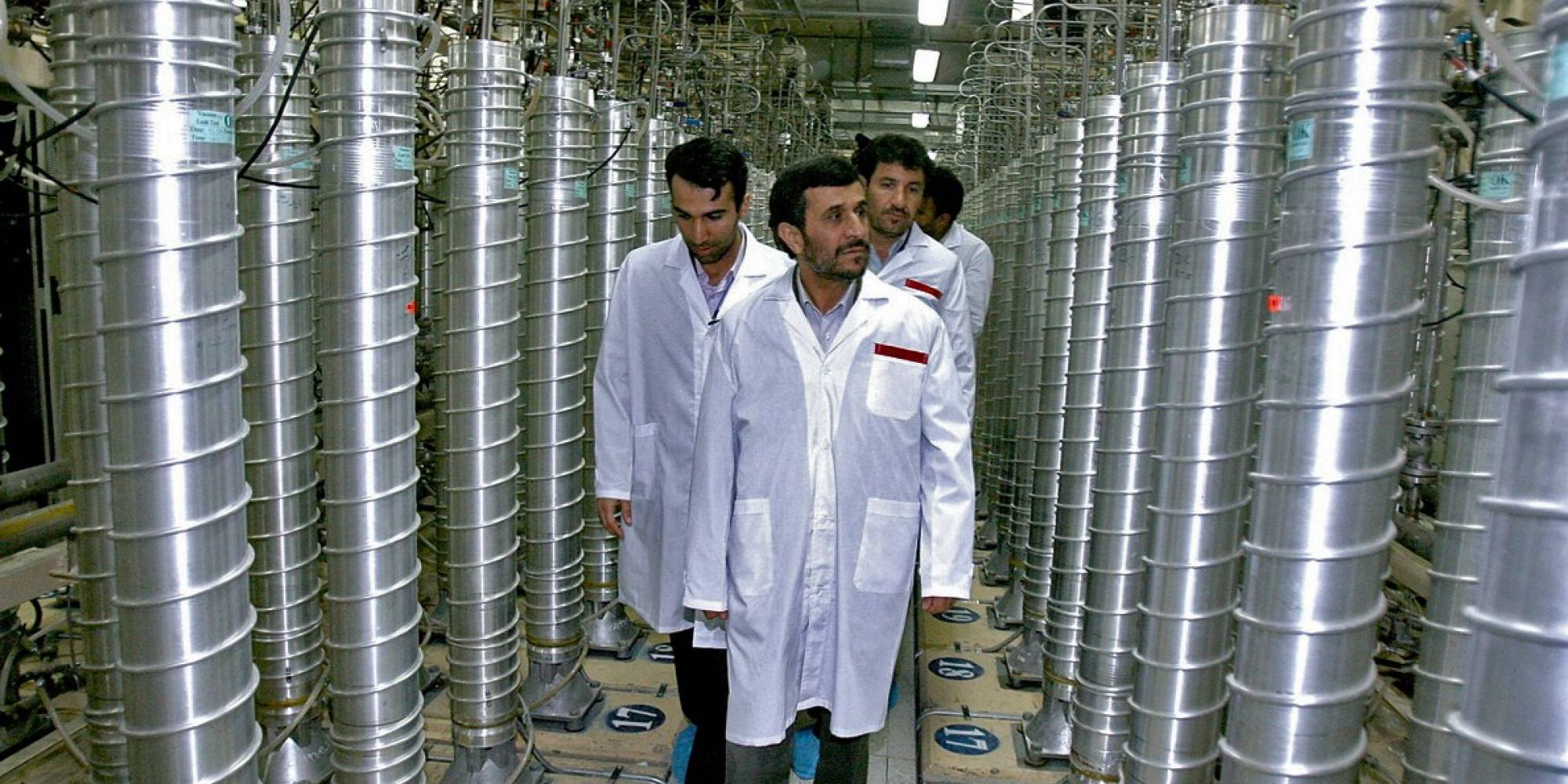 people walk through field of nuclear centrifuges